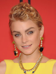 Jessica Stam loaded up on the bling, including a chunky pair of dangling gemstone earrings and layers of necklaces.