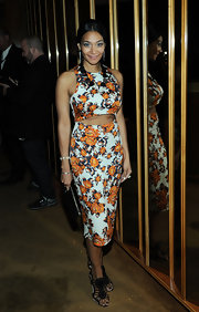 Monique Pean chose a bright floral frock with a fun cutout detail for her look at the CFDA Fashion Awards after party.