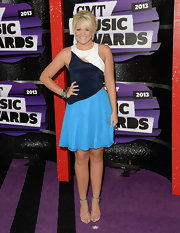 Lauren Alaina chose a color-blocked white, navy, and sky blue cutout dress for the CMT Music Awards red carpet.
