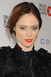 Coco Rocha pinned back her red locks into this slightly undone 'do.
