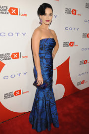 Katy Perry showed she's not afraid of bold colors and prints at the 2013 Delete Blood Cancer Gala where she wore this strapless blue gown with a fit and flare skirt.
