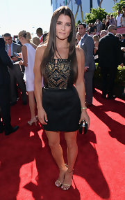 Danica showed off her toned arms and legs with this black dress with an embellished bodice, leather panels and a suede skirt.