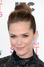 Katie Asleton opted for a classic top knot bun for her look on the Independent Spirit Awards carpet.