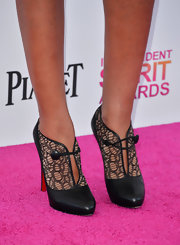 Terri Seymour exuded elegance in these lace black booties.
