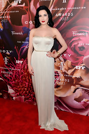 Dita Von Teese chose a rich cream-colored strapless dress with a subtle gold trim for her look at the Fragrance Foundation Awards.