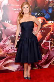 Connie showed off her impeccable style with this deep midnight blue strapless dress.