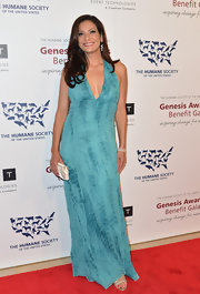 Constance Marie chose a teal evening dress with a plunging neckline for her red carpet look.