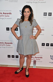 Nikki Boyer chose a basic striped frock with puffed sleeves for her fun and preppy red carpet look.