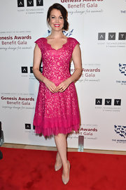 Bellamy Young chose a fun and flirty fuchsia frock with an embroidered lace V-neck and capped sleeves for her red carpet look.