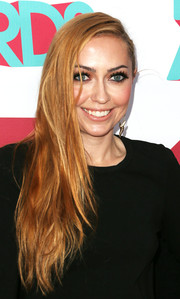 Brandi Cyrus fixed her long hair in an edgy side sweep for the HALO Awards.