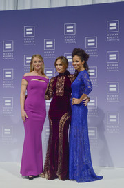 Teri Polo donned a super-sophisticated purple off-the-shoulder gown with peekaboo detailing for the HRC National Dinner.