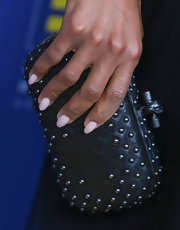 Kerry Washington added a touch of edge to her feminine gown with this studded, knot clutch.