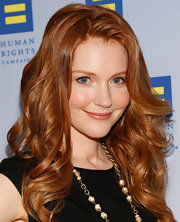 Darby Stanchfield's strawberry locks looked shiny and bright when styled into voluminous, bouncy curls.