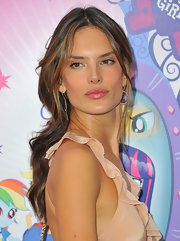 Alessandra added a swipe of pink lip gloss to make her supple lips stand out even more.