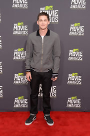 Logan Lerman chose a gray zip-up jacket for his look at the MTV Movie Awards.
