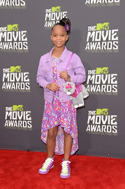 Quvenzhane Wallis totally rocked a floral-print, purple fishtail dress and matching jean jacket at the MTV Movie Awards.
