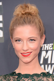 Caitlin Gerard chose a messy top knot for her chic but sophisticated red carpet look.