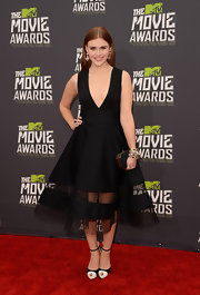 Holland Roden stunned in an A-line LBD, which featured a deep V-neck and a full mesh-paneled skirt.