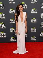 Melanie Iglesias took the plunge at the MTV Movie Awards, where she sported this white floor-length gown with a deep V-neck.