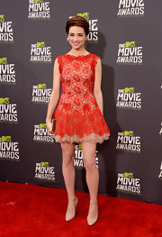 Crystal Reed chose a red lace frock for her fun and flirty red carpet look at the 2013 MTV Movie Awards.