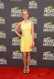 Kelley Jakle topped off her chic red carpet look with a yellow frock that featured a beaded neckline.