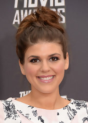 Molly Tarlov added some major shine to her red carpet look with a blush pink lip gloss.