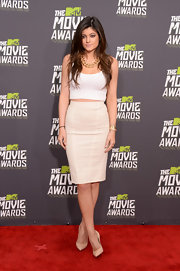 Kylie Jenner rocked a white bodycon crop top and matching nude pencil skirt at the 2013 MTV Movie Awards.