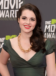 Vanessa Marano topped off her glam style with crimson red lips. Va-va-voom!