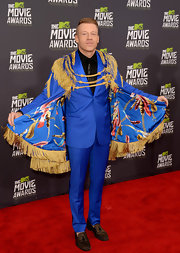Macklemore rocked this eclectic blue printed cape with gold tassels and epaulets.