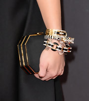 Holland Roden kept her look black from head to toe with this hard case, satin clutch.