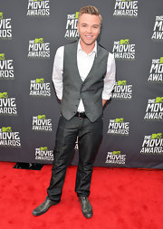 Brett Davern dressed up his look with a sleek gray vest.