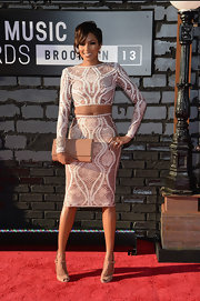 Alicia's crocheted pencil skirt and matching top made the midriff look red carpet appropriate.