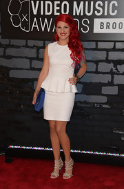 Carly's vibrant red waves stood out against her crisp white peplum dress at the VMAs.