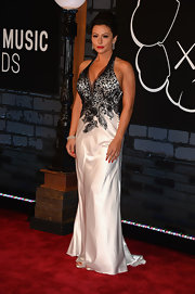 Jenni's silver and black lace evening gown showed off her curves on the red carpet.