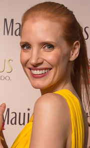 Jessica Chastain let her fresh face be the center of attention by sweeping back her strawberry locks into a simple ponytail.