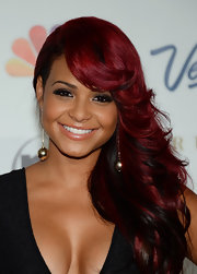 Christina showed off her ruby red locks at the Miss USA Pageant with this feathered side sweep.