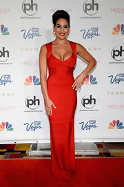 Nikki showed off her fit figure in this curve-hugging bandage dress in a rich crimson hue.