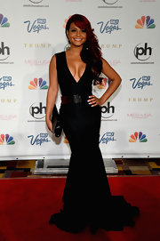 Christina Milian's plunging neck black dress featured a fitted mermaid skirt.