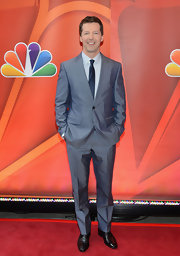 Sean Hayes looked sleek and sophisticated in a two-button, notch-lapel silver suit.