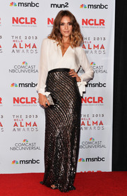 Jessica Alba selected a loose white Juan Carlos Obando blouse with bow tie sleeves for the 2013 NCLR ALMA Awards.
