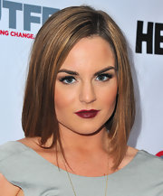 Jojo kept her look streamline from head to toe when she style her caramel hair into a sleek shoulder-grazing 'do.