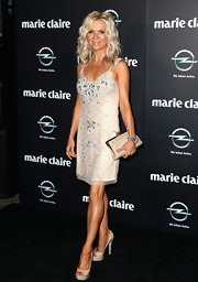 Danielle Spencer chose a nude beaded cocktail dress for her Art Deco, flapper-inspired evening look.