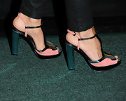 Cheryl Hines added just a touch of color to her all-black look with this pink and black sandal.