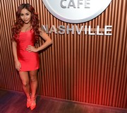 Nicole Polizzi slipped into a slinky red mini dress for the Smart Tan Downtown Convention after-party.