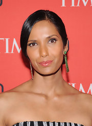 Padma Lakshmi topped off her minimal beauty look with a super shiny lip gloss.