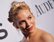 Sienna Miller stuck to her cool boho style when she opted for a twisted bun accessorized with a beaded headband.