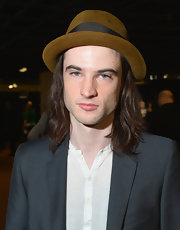Tom Sturridge kept his look casual and hip with a brown porkpie hat.