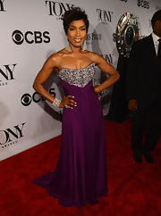 Angela Bassett chose a deep plum-colored strapless dress with a beaded bodice for the red carpet of the 2013 Tony Awards.