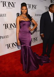 Condola Rashad chose a deep eggplant mermaid gown with a fitted bodice for her red carpet look at the 2013 Tony Awards.