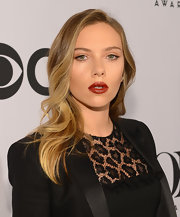 Scarlett Johansson made her pout look luscious and supple with a deep crimson lipstick.